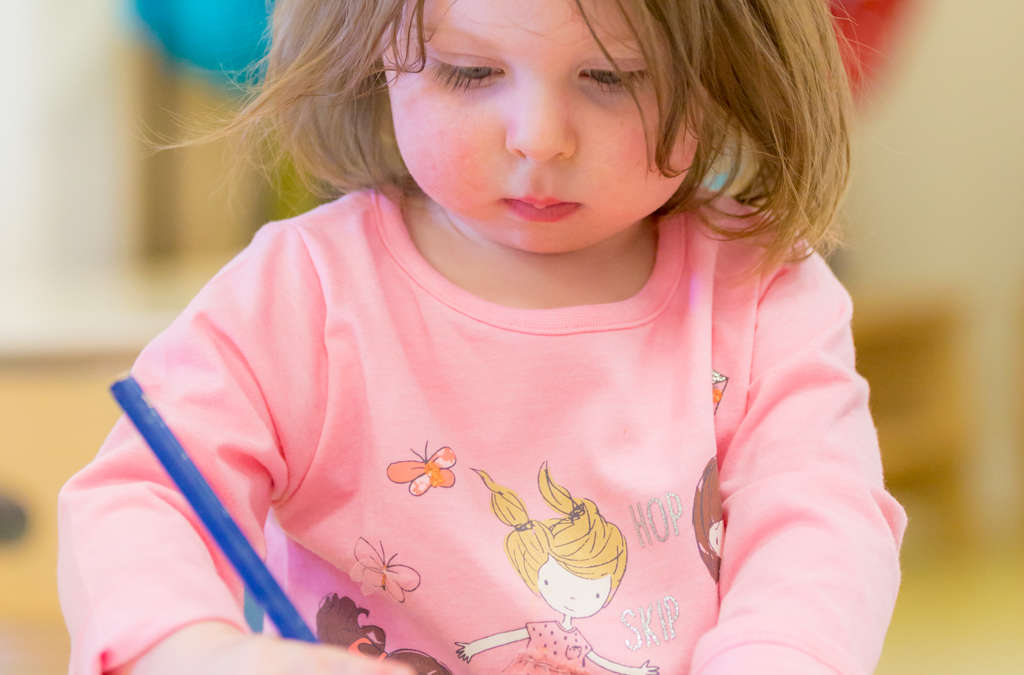Little girl drawing at Truro Treliske Happy Days Nursery childcare