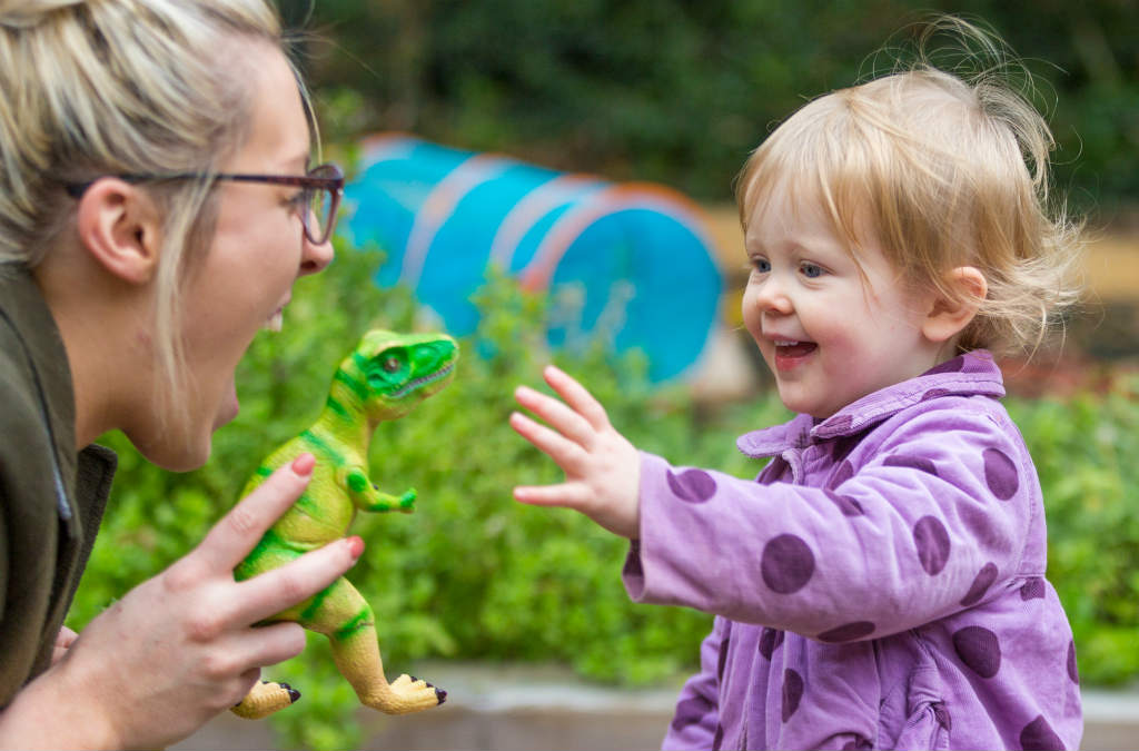 Toddler with nursery carer