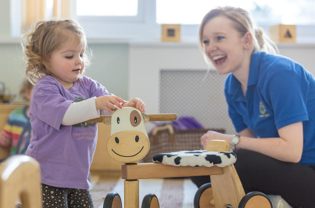 Girl smiling at Happy Days nursery